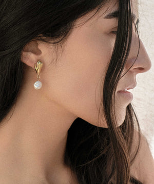Giving hand pearl drop earring