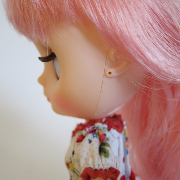 Middie Blythe with pierced ears