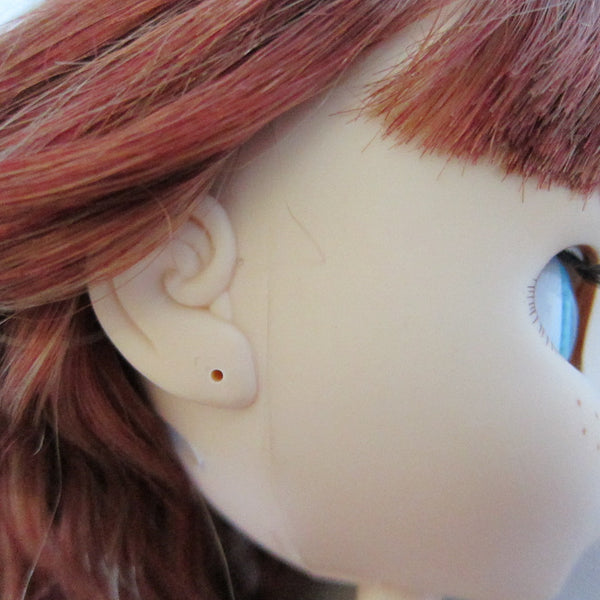 Doll with pierced ears