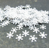 Snowflake confetti in two different designs