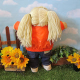 Vintage Cabbage Patch Kids girl doll with blonde pigtails