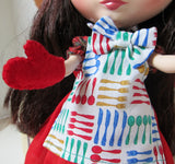 Blythe Apron with Red, Yellow, Green and blue knives, spoons, and forks