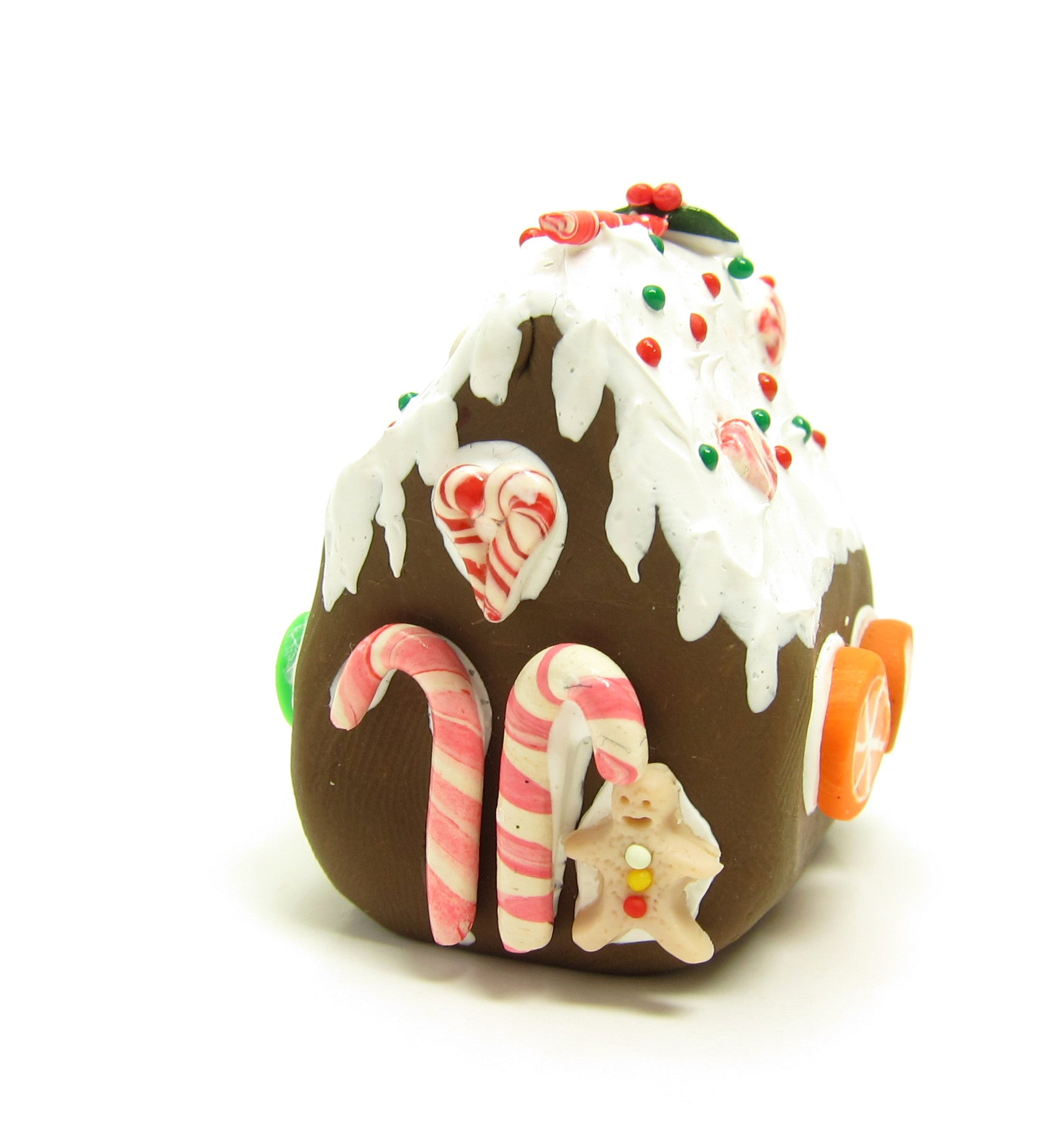 Miniature polymer clay gingerbread house with candy
