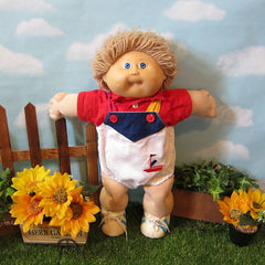 Cabbage Patch Kids boy doll with light brown hair, blue eyes, dimples, tooth