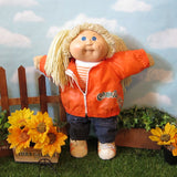 Cabbage Patch Kids girl doll with blonde hair and blue eyes