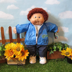 Cabbage Patch Kids boy doll with brown hair, brown eyes, tooth