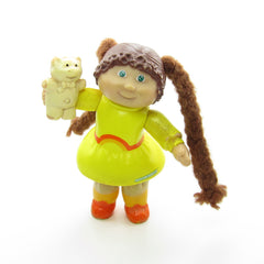 Cabbage Patch Kids poseable figure girl in yellow dress