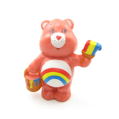 Cheer Bear painting a colorful rainbow Care Bears figurine