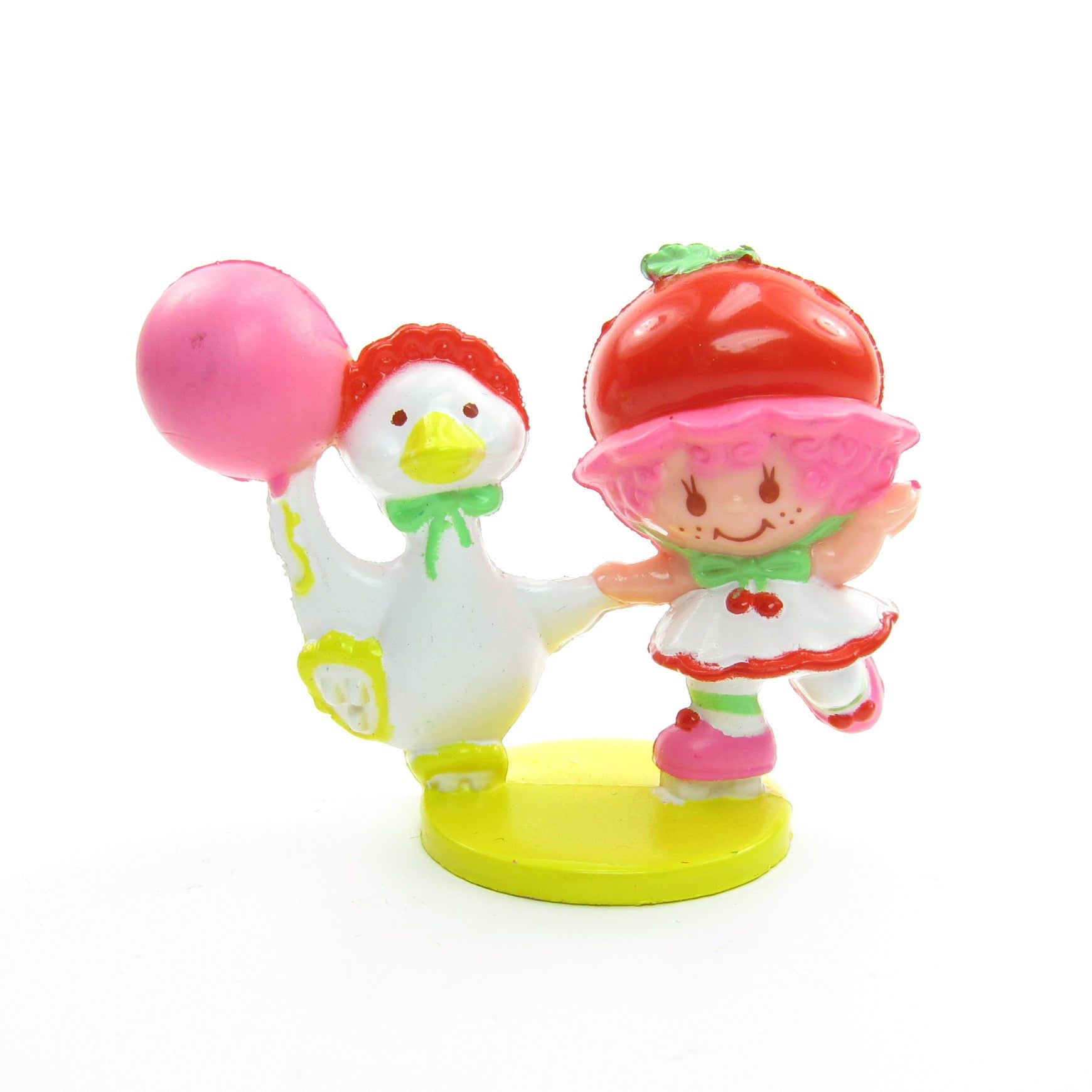 Cherry Cuddler and Gooseberry roller skating figurine