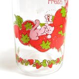 Custard cat and strawberries on vintage glass jar