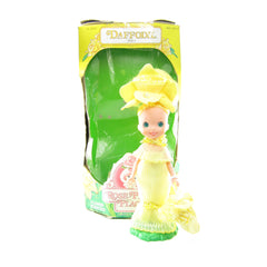 Rose Petal Place Daffodil doll with hat, dress, stand, purse, and box