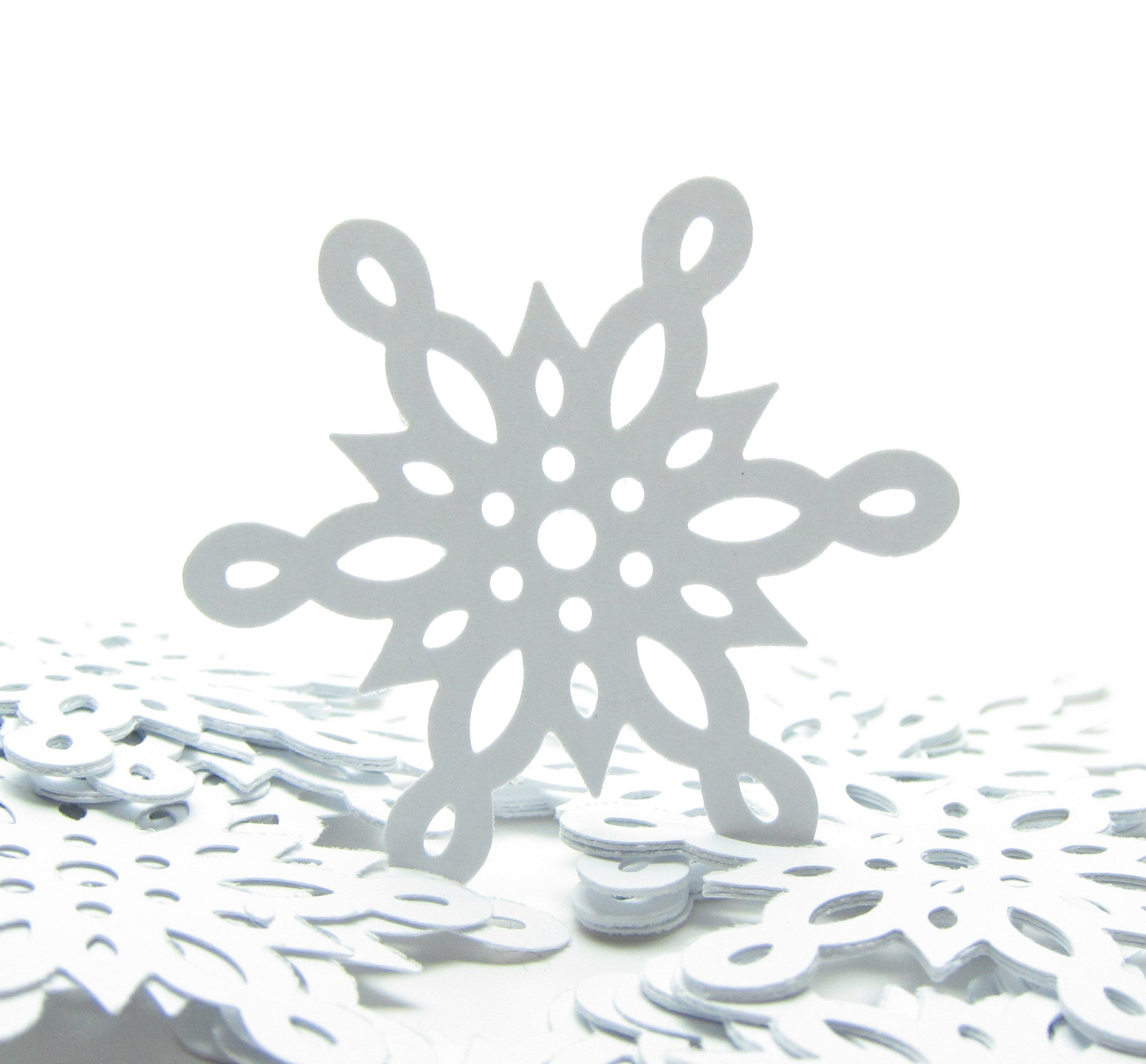 White scalloped snowflake paper punches