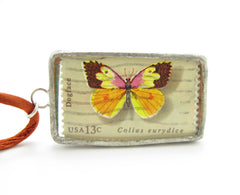 Dogface butterfly postage stamp in pendant