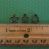 Dollhouse miniature star, gingerbread boy, and Christmas tree cookie cutters