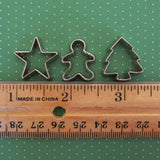 Miniature star, gingerbread boy, and tree cookie cutters