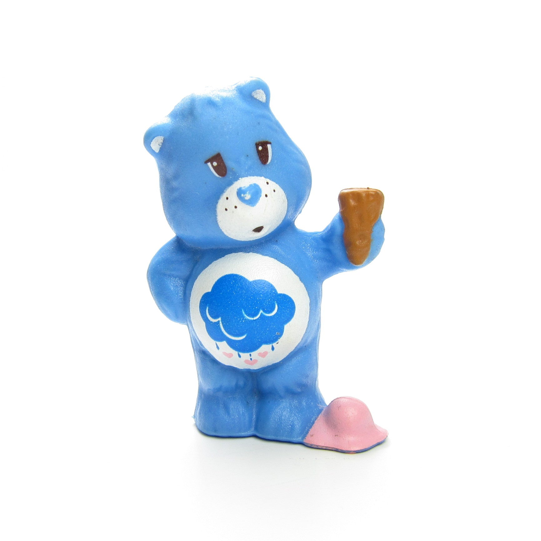 Grumpy Bear Spilling Ice Cream on His Foot figurine