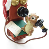 Chipmunk talking on old fashioned telephone ornament