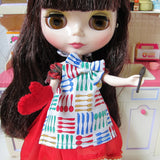 Blythe cooking apron with bow, oven mitt, and wooden spoon