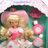 Peppermint Rose doll with liquid stains in box