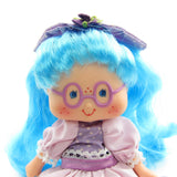 Close-up of Plum Puddin Berrykin doll's face