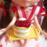 Polymer clay miniature strawberry shortcake with strawberries and whipped topping