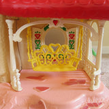 Yellow porch swing on Strawberry Shortcake Berry Happy Home dollhouse