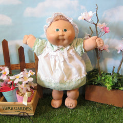 Cabbage Patch Kids Preemie girl doll with light brown hair, green eyes, dimple