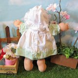 Cabbage Patch Kids Preemie girl doll with white bonnet, green dress