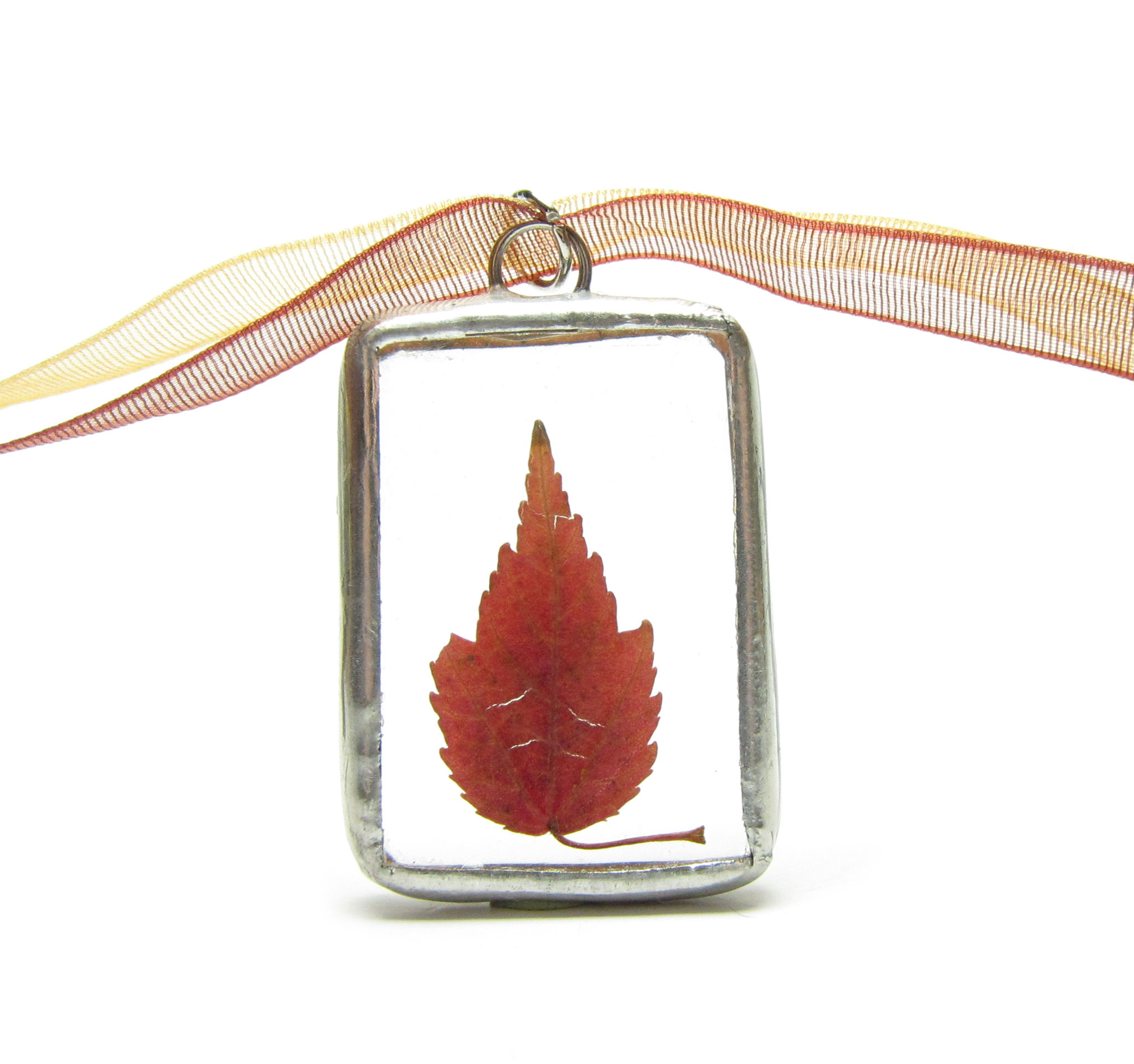 Soldered glass pendant necklace with red maple leaf