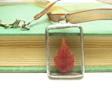 Red maple leaf in soldered glass pendant