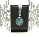 Pale blue winter solstice moon stained glass pendant