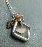 Soldered glass fairy wing necklace with oak leaf charms