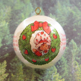 Strawberry Shortcake Christmas ornament with wreath