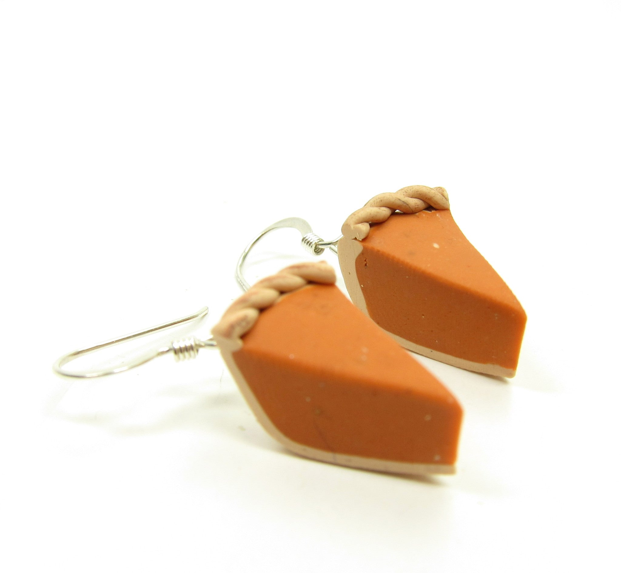 Polymer clay earrings with pumpkin pie slices