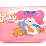 Poochie with comb and mirror on front of Poochie plastic case