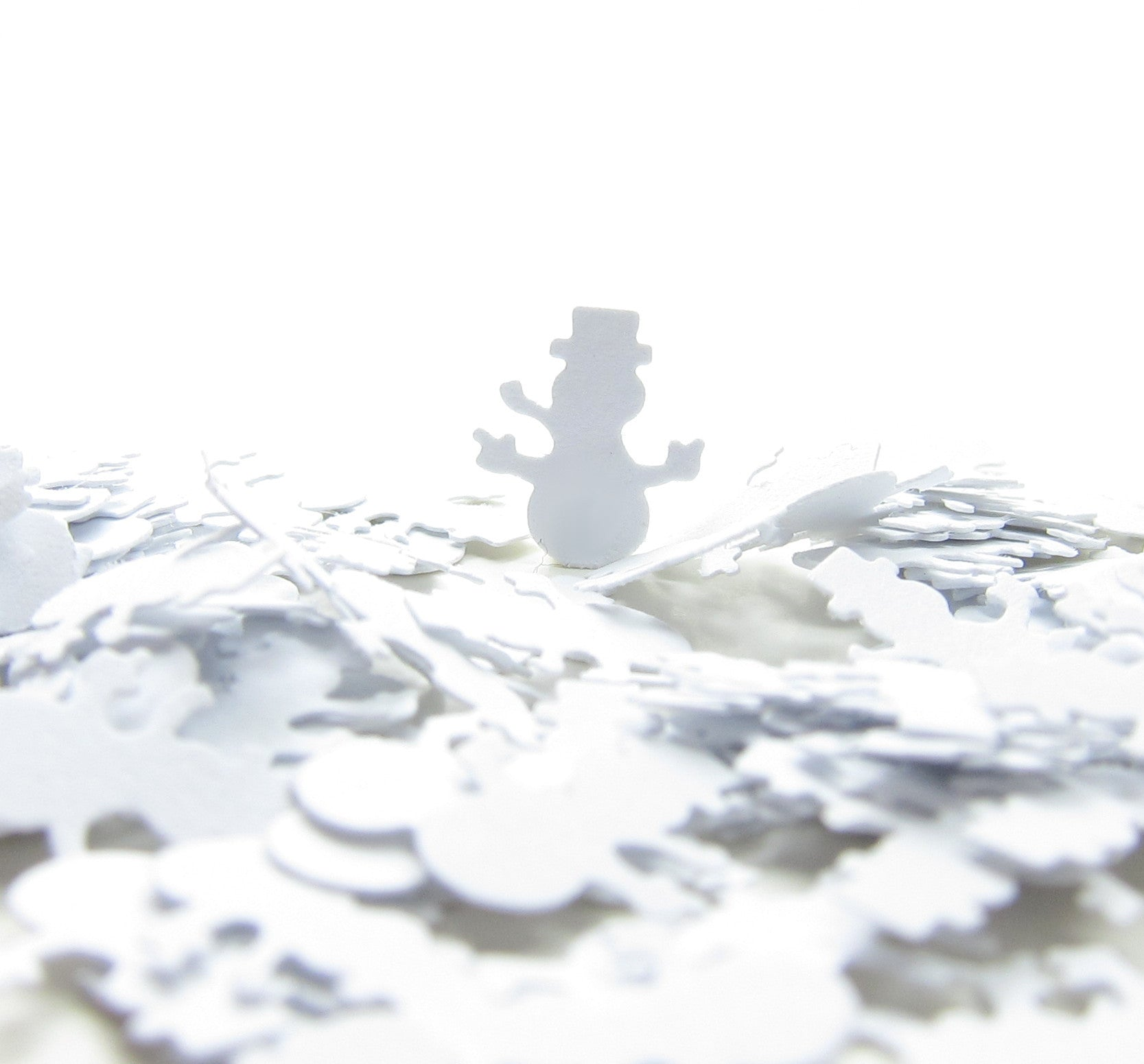 Paper punched snowman shapes