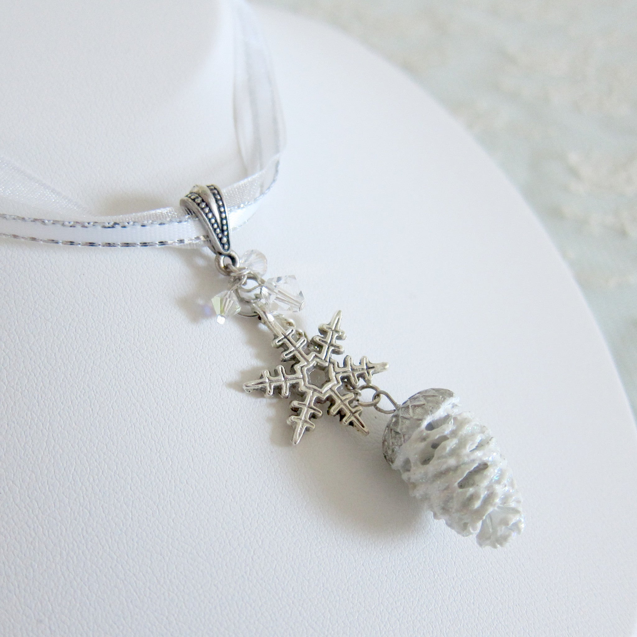 Snowflake Pine Cone Necklace on White Ribbon