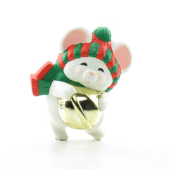 White mouse with red and green hat and scarf and gold jingle bell pin