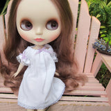 White Blythe doll nightgown with lace trim and purple ribbons