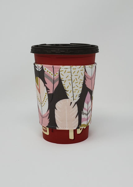 Reusable cup cozy displayed on a medium coffee cup - Feathers