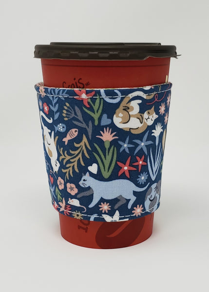 Reusable cup cozy displayed on a medium coffee cup - Feline Good