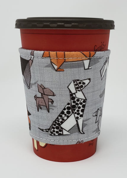 Reusable cup cozy displayed on a medium coffee cup - Origami Dogs