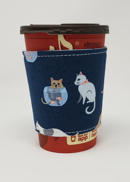 Reusable cup cozy displayed on a medium coffee cup - Are You Kitten Me?