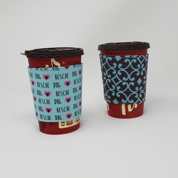 Reusable cup cozy displayed on a medium coffee cup - Rescue Dogs