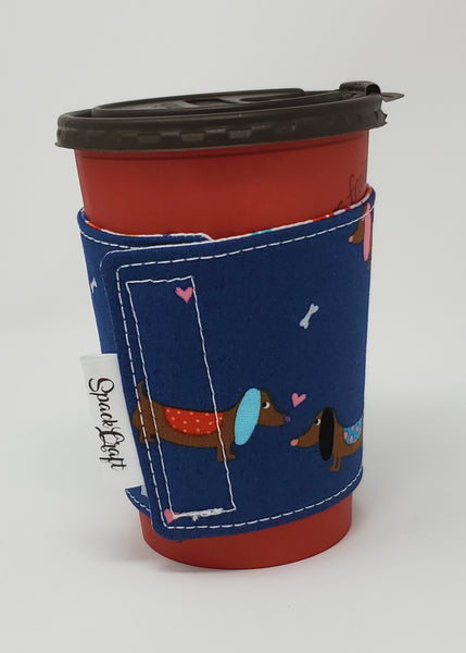 Reusable cup cozy displayed on a medium coffee cup featuring tag - Blue Dachshunds and Hearts