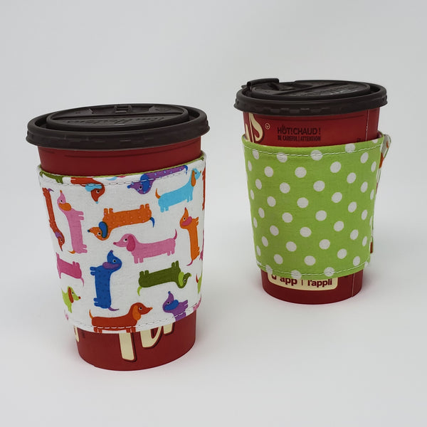Reusable cup cozy displayed on a medium coffee cup - Spring Dachshunds