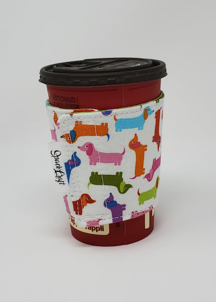 Reusable cup cozy displayed on a medium coffee cup featuring tags - Spring Dachshunds