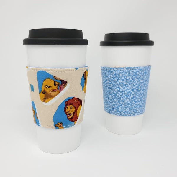 Reusable cup cozy - Lion King -  both sides displayed on a coffee cup