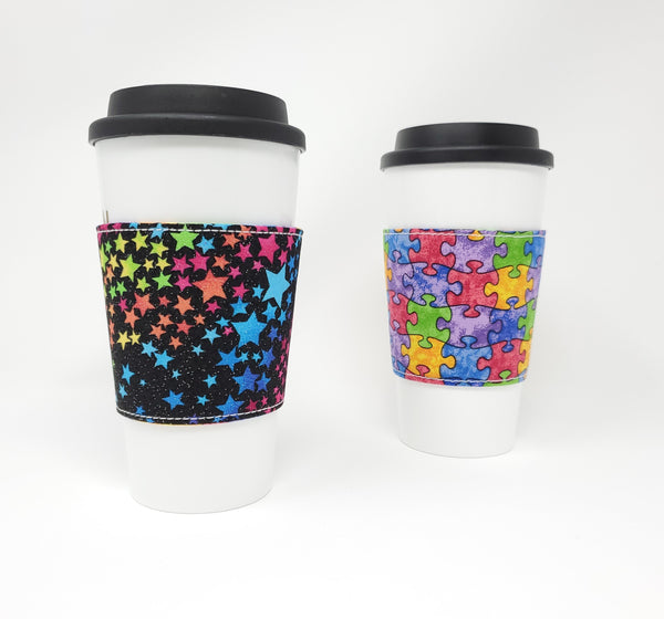 Reusable cup cozy - Glitter Rainbow Stars - Pictured on a cup