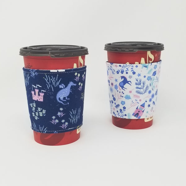 Reusable cup cozy displayed on two medium coffee cups to display both prints - Avalon